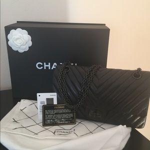 Like new, Chanel so black chevron reissue 225